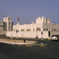 """White houses at the roadside Muscat Oman"" by Panoramic Images"
