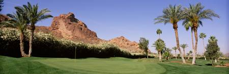 Golf course near rock formations