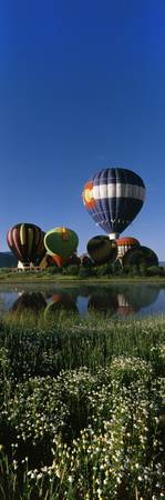 Reflection of hot air balloons in a lake Hot Air