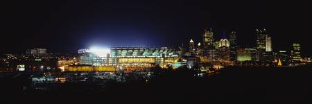 Stadium lit up at night in a city