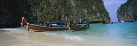 Longtail boats moored on the beach