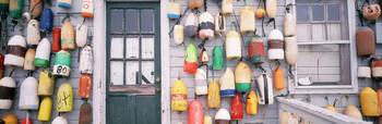 Large group of buoys hanging on a shack