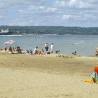 """Tourists on the beach Traverse City Grand Travers"" by Panoramic Images"