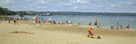 Tourists on the beach Traverse City Grand Travers
