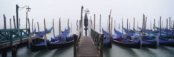 Gondolas moored in a canal