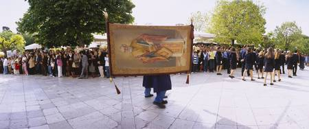 Person carrying a banner in an Easter procession