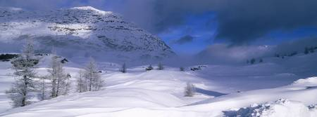 Snowcapped mountain in a polar landscape