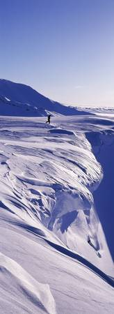 Person walking on a snow covered mountain