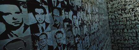 Close-up of photographs on a wall