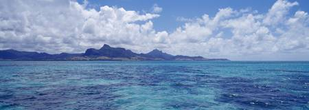 Ocean with mountains in the background Mauritius