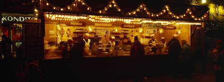People in a Christmas market at night Munich Bava