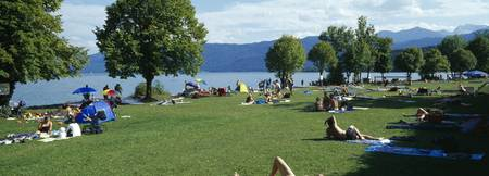 Tourists sunbathing at the lakeside Walchensee Ba