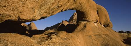 Natural arch on a mountain Spitzkoppe Namib Deser