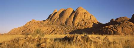 Rock formations in a desert at dawn Spitzkoppe Na