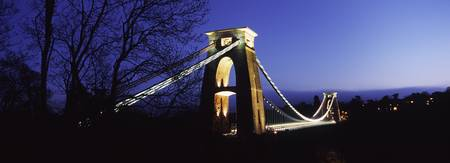 Suspension bridge lit up at night