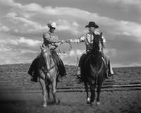 Two Cowboys on Horseback