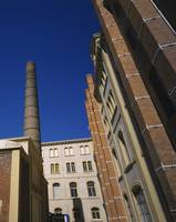 Low angle view of a chimney of a tobacco factory