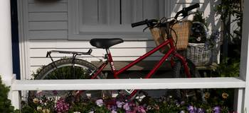 Bicycle parked on a porch of a house