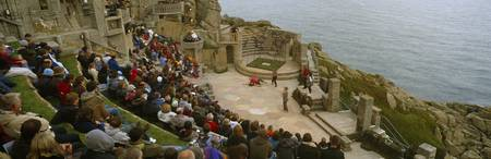 Spectators watching play in an open air theatre M