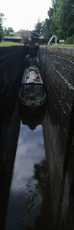 Narrow boat in a canal lock Marple Lock Flight Pe
