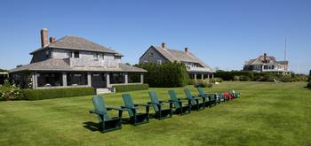Houses with adirondack chairs in a lawn