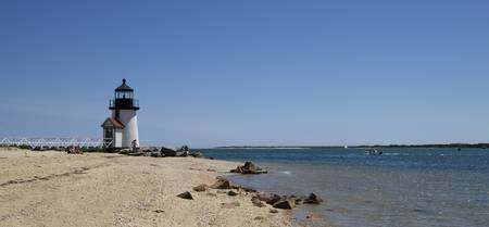 Beach with a lighthouse in the background