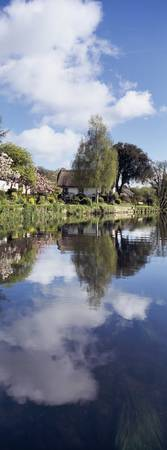 Reflection of a cottage in a river Bickleigh Rive