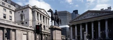 Equestrian statue in front of a bank building Ban