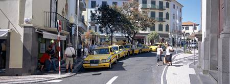 Taxis in a row on the road