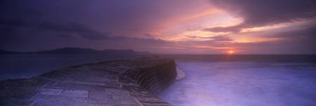 Sea at dawn The Cobb Lyme Regis Dorset England