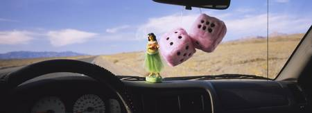 Fuzzy dices hanged on a rear view mirror with a h
