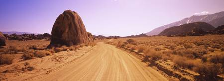 Dirt road passing through an arid landscape