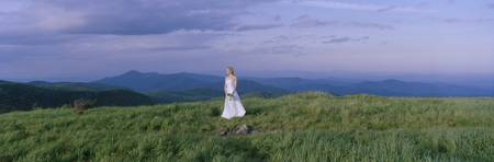 Bride standing in a field