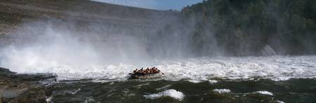 Group of people rafting in a river