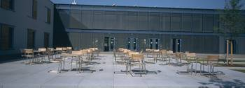 Chairs in the courtyard of a school building