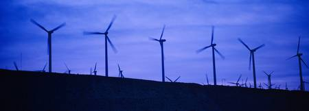 Wind turbines in a row at dusk