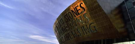 Text carved on the wall of an arts centre Wales M