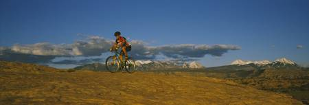 Low angle view of a person mountain biking