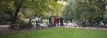 Group of people and bicycles in a park