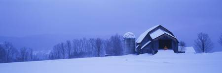 Silo on a snowcapped landscape