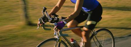 Side profile of a woman cycling