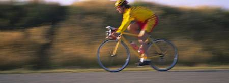Side profile of a man cycling