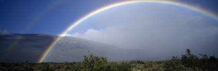 Rainbow over Mauna Loa mountain