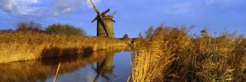 Reflection of a traditional windmill in water Bro