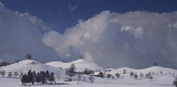 Cloudy sky over snowcapped hills