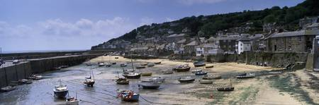 Boats at a harbor Mousehole Cornwall England