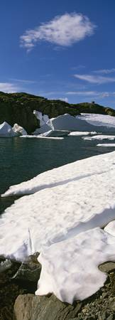 Icebergs and snow on lake