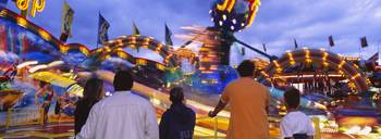 Rear view of five people at an amusement park