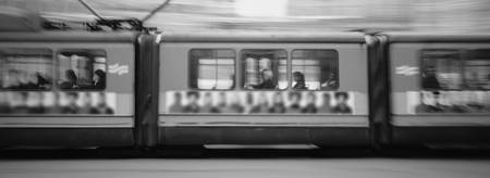 Group of people traveling in a street car