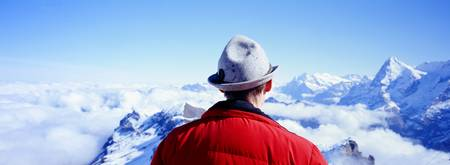 Man Contemplating Swiss Alps Switzerland